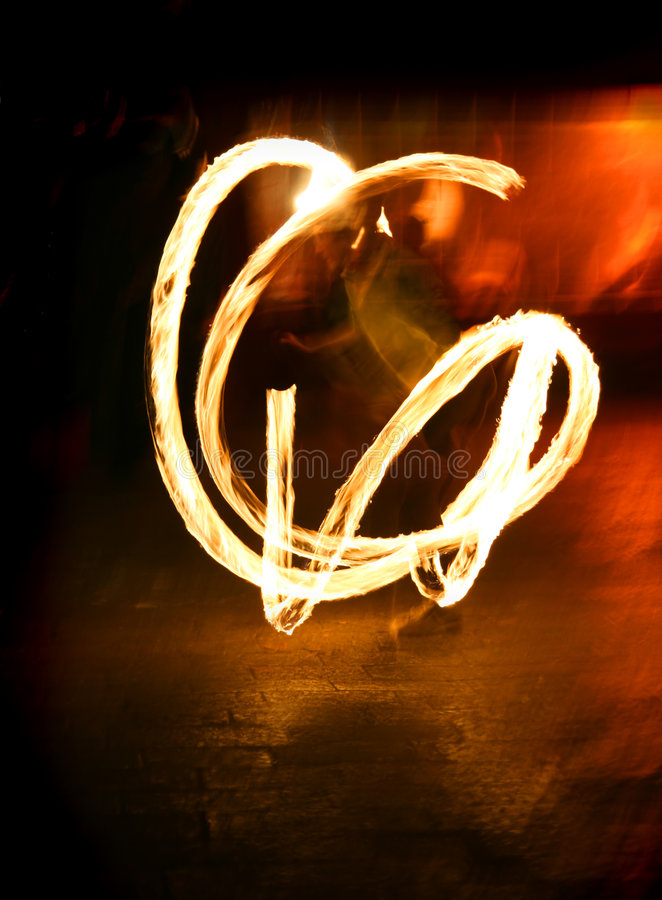 Fire juggler. Light trails during Venice carnival stock photography