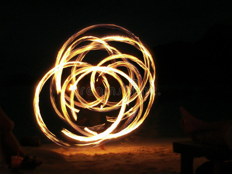 Fire Juggler In Full Swing. On a beach in Krabi, Thailand royalty free stock photo