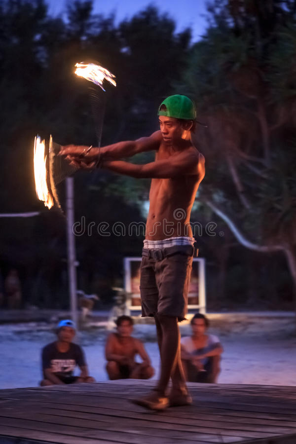 Fire juggler. Kid juggling with fire in Gili islands royalty free stock images