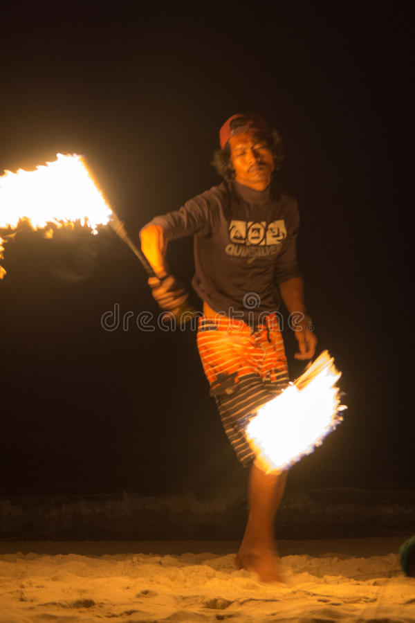 Fire juggler. Performing fire show. Picture taken on Perhentian Kecil island, Malaysia stock photography