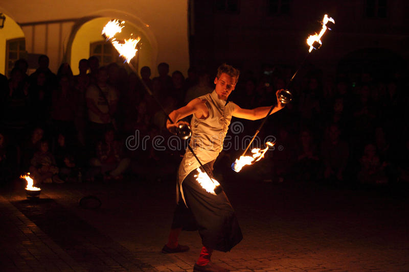 Fire juggler. Sibiu, Romania - June 11, 2013: Sibiu International Theatre Festival. A fire show called Are there Alps in Vienna? presented by the group Fenfire stock images