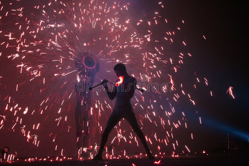 Fire Jugglers. A fire jugling and pyrotechnics performance stock photo
