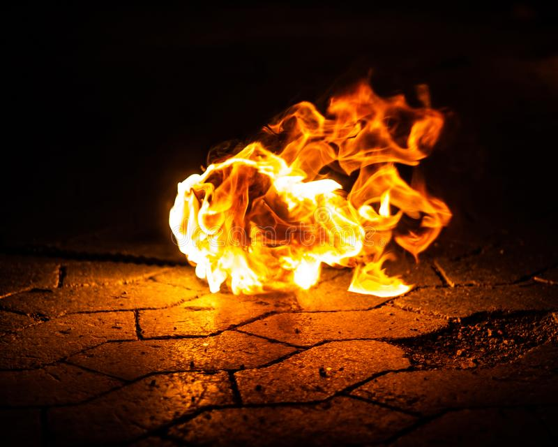 Fire lying on the ground royalty free stock photos
