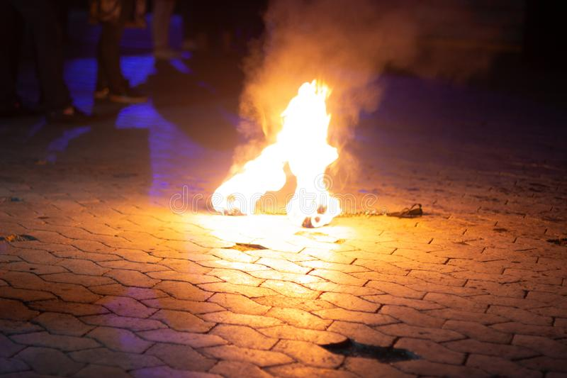 Fire lying on the ground. Fire show. Special tool stock image