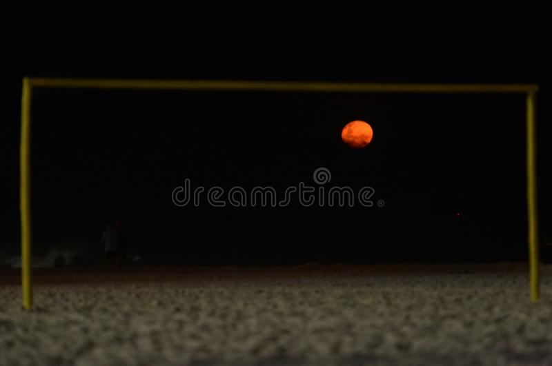 Fire moon. On soccer goal stock images