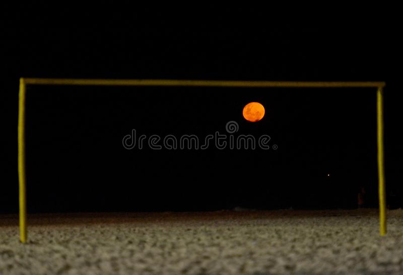 Fire moon. On soccer goal royalty free stock photography