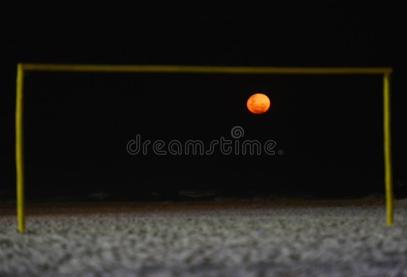 Fire moon. On soccer goal stock photos
