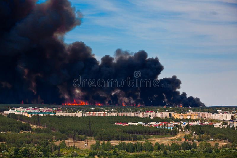 Fire Near To Apartment Houses Stock Images