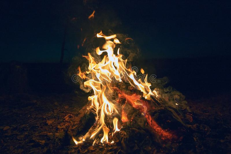 Fire at night against the dark sky. royalty free stock images