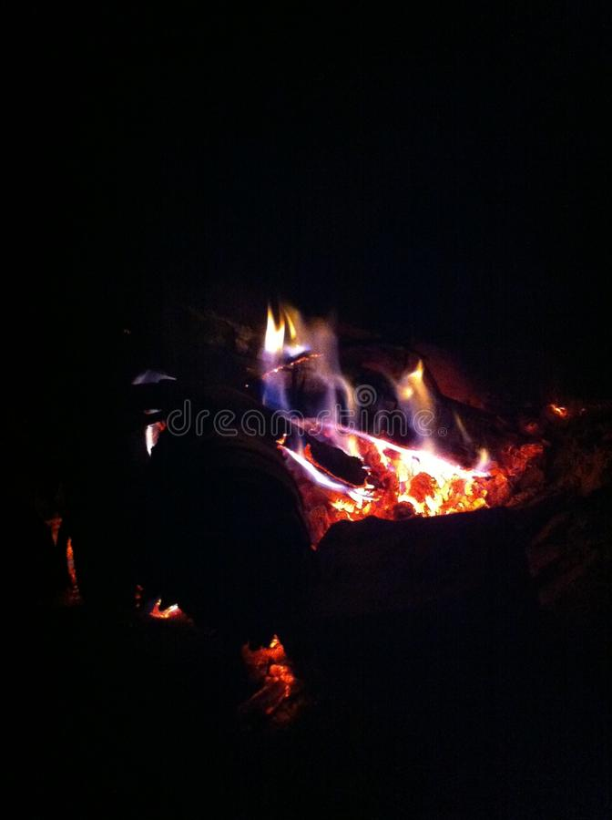 Fire in the night, completely black background royalty free stock photos