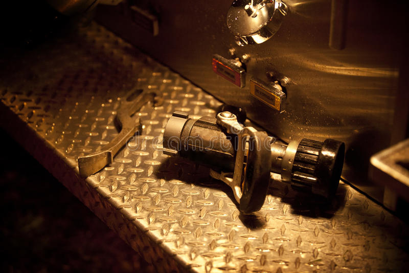 Fire Nozzle and Wrench royalty free stock images