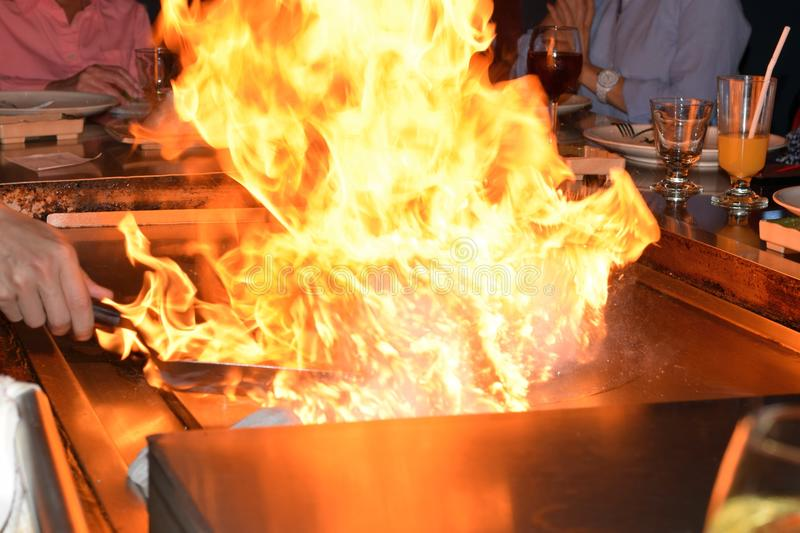 Fire Over Hibachi. Cook made fire on hibachi grill background fire space for annotation royalty free stock photo