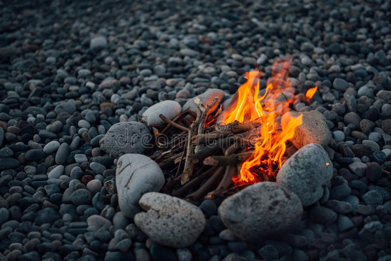 Fire overlaid with stones burning. Fire overlaid with stones is burning stock photo