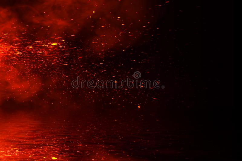 Fire particles embers with reflection in water. Design texture for banner,flyer,card. And poster stock photos