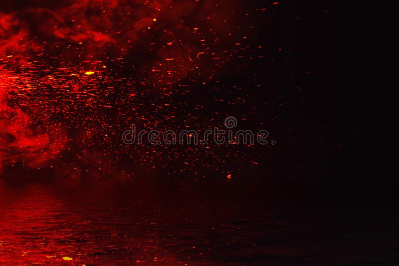 Fire particles embers with reflection in water. Design texture for banner,flyer,card. And poster royalty free stock image