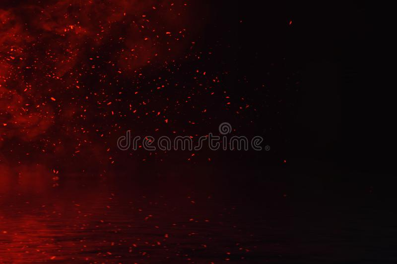 Fire particles embers with reflection in water. Design texture for banner,flyer,card. And poster stock images