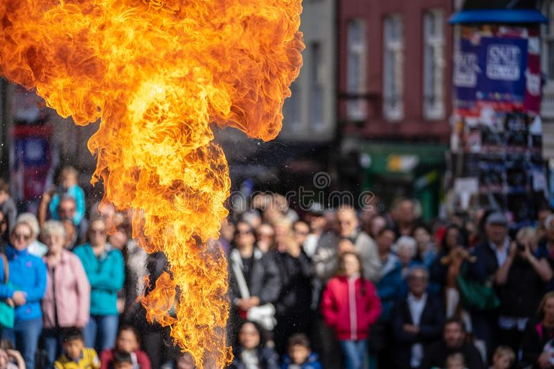 Fire performance includes skills based on juggling, baton twirling, poi spinning, and other forms of object manipulation.  royalty free stock images