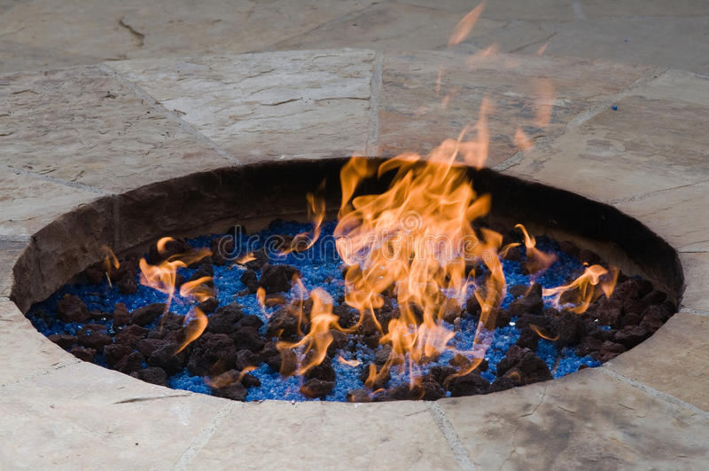 Fire pit. Ornamental fire pit with lava rocks and crystals royalty free stock images