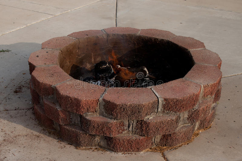 Fire Pit. Image of a backyard fire pit with a fire in it stock photography