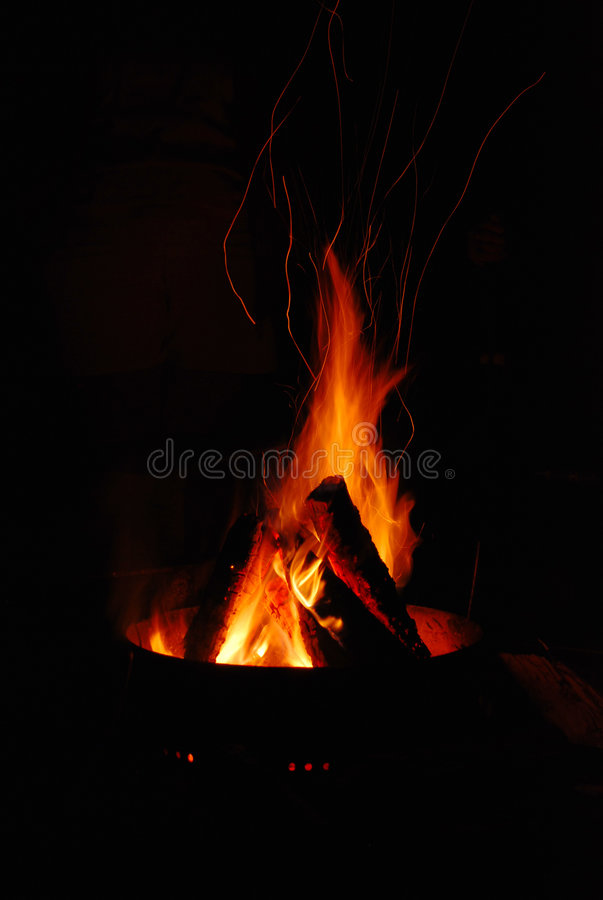 Fire Pit. A flickering fire pit at night while camping royalty free stock photography