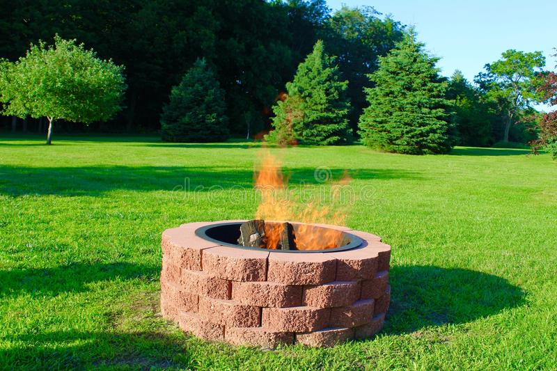 Fire Pit. Handmade outdoor red brick fire pit stock images