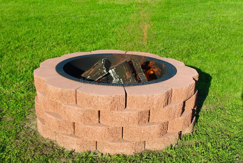 Fire Pit. Handmade outdoor red brick fire pit royalty free stock images