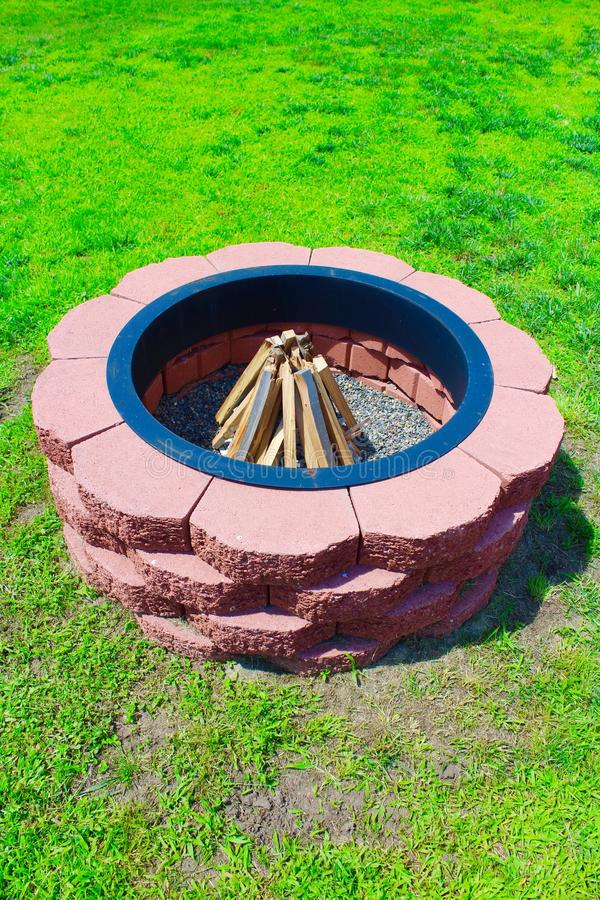 Fire Pit. Handmade outdoor red brick fire pit royalty free stock image