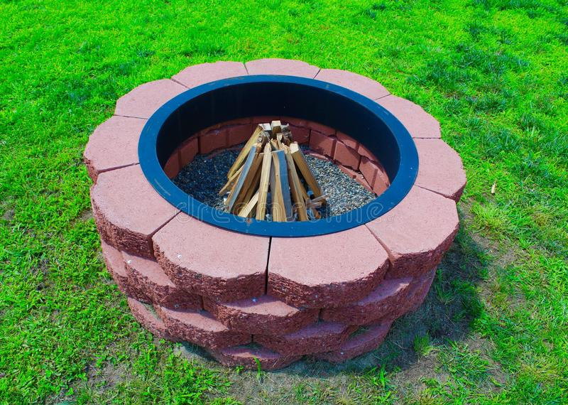 Fire Pit. Handmade outdoor red brick fire pit royalty free stock photos