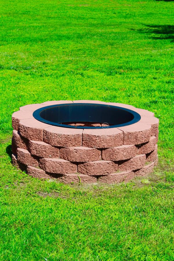 Fire Pit. Handmade outdoor red brick fire pit royalty free stock photo