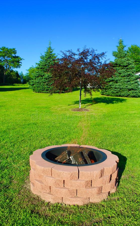 Fire Pit. Handmade outdoor red brick fire pit royalty free stock photography