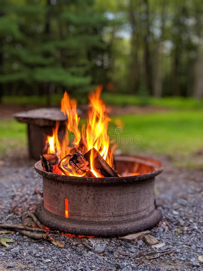 Fire pit in outdoor setting on summer evening.  stock image