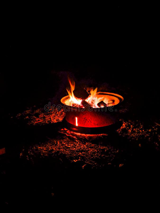 Fire pit in outdoor setting on summer evening stock photography