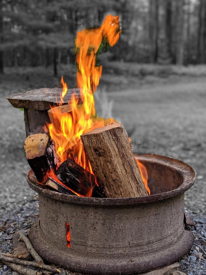 Fire pit in outdoor setting on summer evening. Selective color.  stock photo