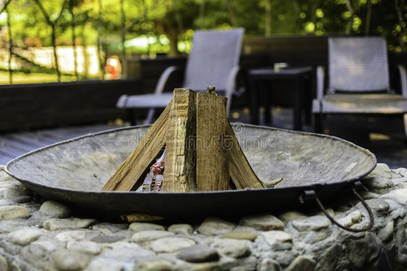 Fire place. In a patio with wood ine royalty free stock image