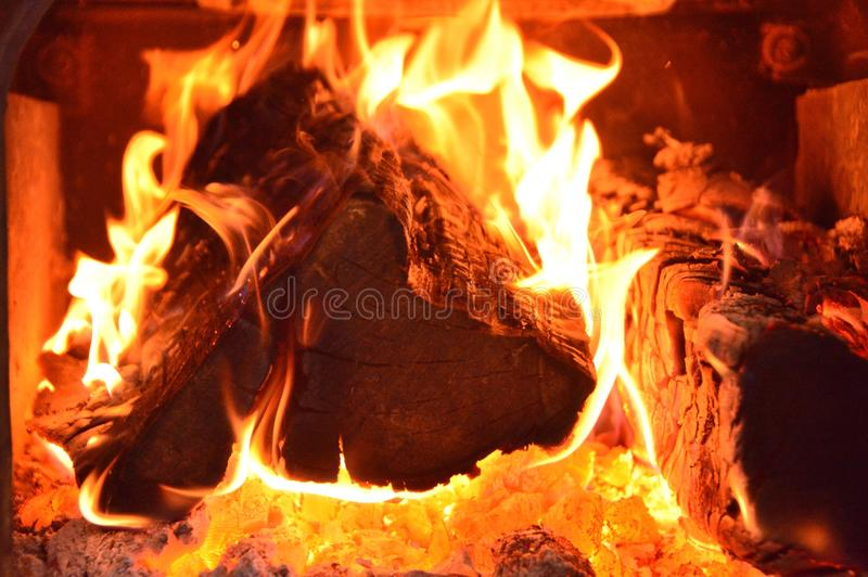 Burning logs. A close up of burning logs in a fireplace stock photo