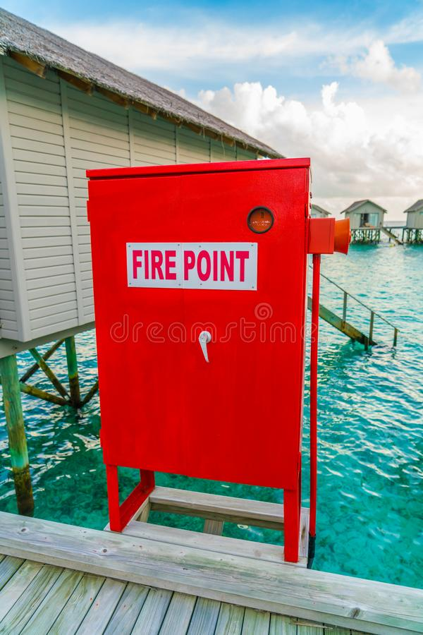 Fire point sign at Beautiful water villas in tropical Maldives i royalty free stock image