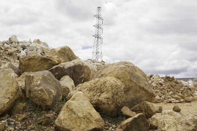 Fire pole building steel link with clound sky and big stones. Of landscape stock photos