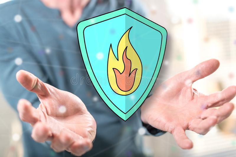 Concept of fire protection. Fire protection concept above the hands of a man in background stock images