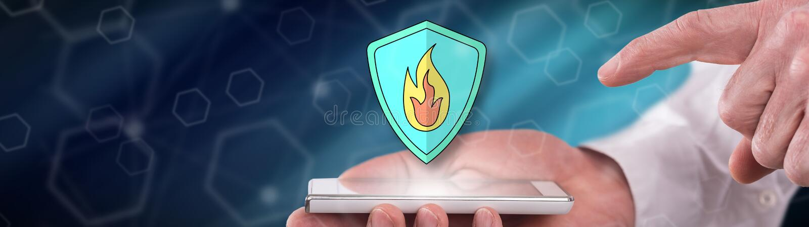 Concept of fire protection. Fire protection concept above a smartphone held by a man royalty free stock photography