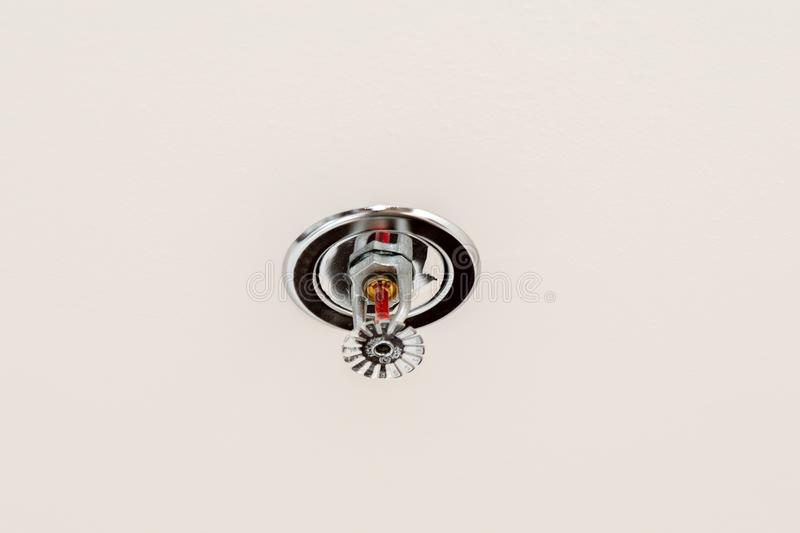 Fire protection. Fire sprinkler head on ceiling. Fire protection. Fire sprinkler head on white ceiling stock photos
