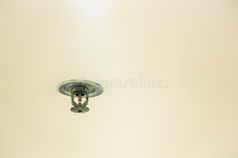 Fire protection.Fire sprinkler head on white ceiling in the building, stock images