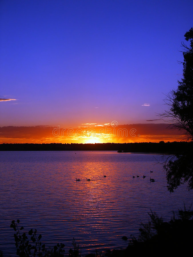 Fire Red Sunrise and a Lake. Lake with Colorful Sunrise at Cherry Creek State Park, in Colorado royalty free stock photo