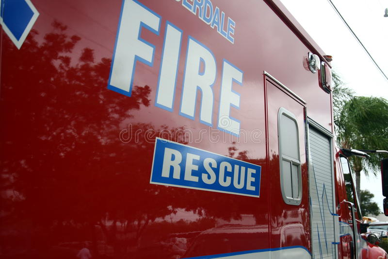 Fire and Rescue Ambulance. Red white and blue fire rescue ambulance in South Florida stock image