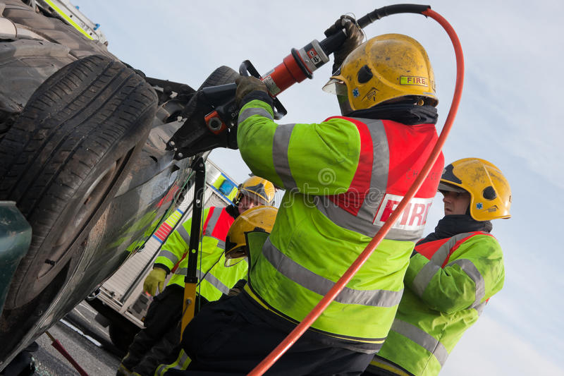 Fire and Rescue service at car crash training stock images