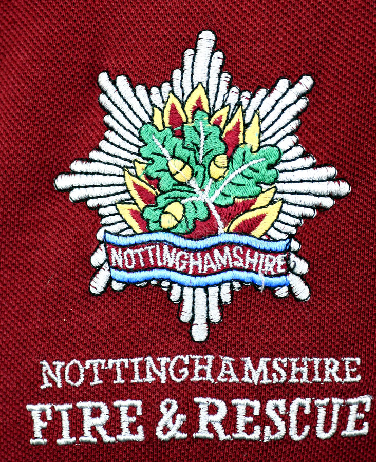 Fire & Rescue Tee-shirt Badge. A embroided Tee-shirt badge for the Nottinghamshire fire & rescue sevice in close-up. August 2013 stock images