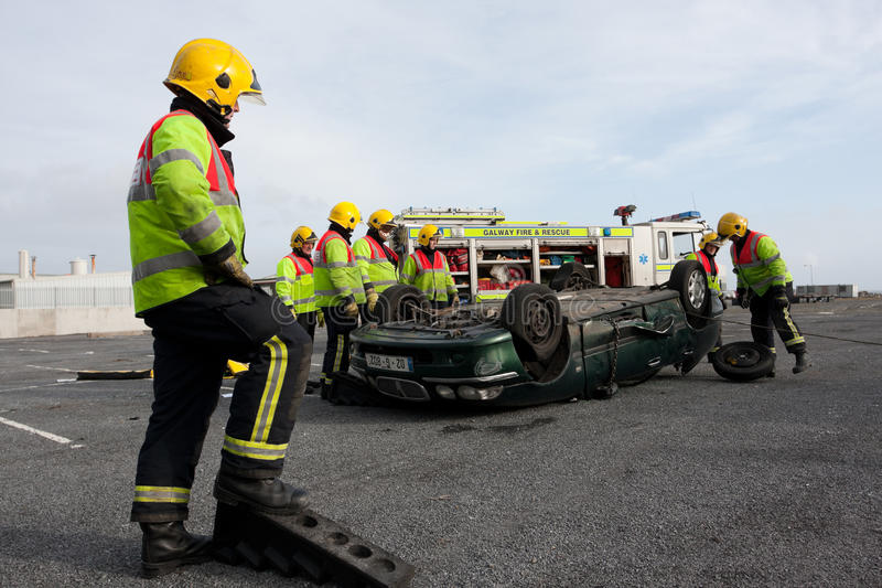 Fire and Rescue uniat car crast h training royalty free stock photos