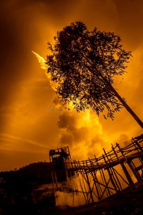 Fire rocket in orange apocalyptic sky. Apocalypse now concept royalty free stock photos