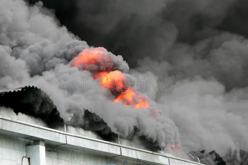 Fire. Roof of an old building caught on fire stock photos