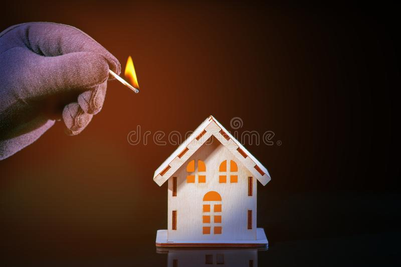 Burning Match and House Model. Fire Safety Concept. Burning Match and House Model royalty free stock images