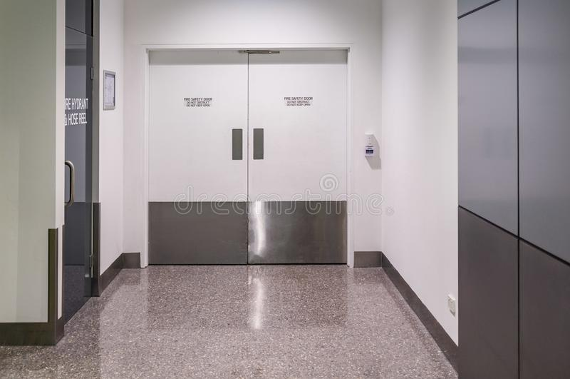 Fire safety door in public building. Fire safety door closeup in public building stock image